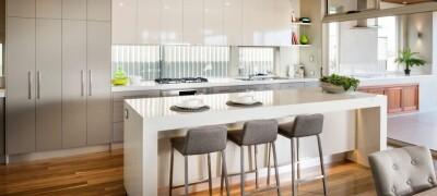 Особенности и правила расположения стола острова на кухне