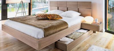 Разновидности двуспальных кроватей с ящиками и их описание