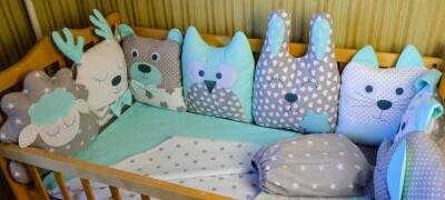 Особенности бортиков для кроватки новорожденного