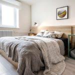 кровать с серым покрывалом длинным