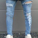 джинсы с дырками и белыми нитками