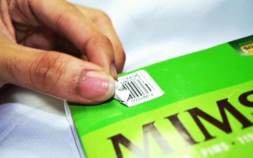 клей от наклейки на бумаге