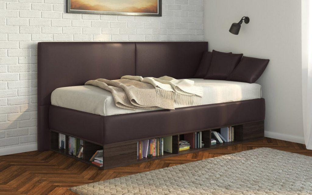 одноместная кровать в углу