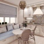 диван у окна на светлой кухне
