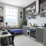 серый гарнитур с синим диваном на кухне