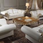 белый кожаный диван с гарниткром