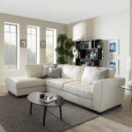 белый кожаный диван с овальным столом