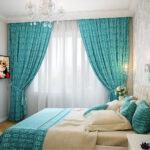 голубые цветастые шторы в спальню