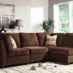 коричневый диван виды декора