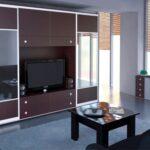 шкаф-купе в гостиной коричневый с тв
