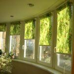 рулонные шторы зеленые на балконе